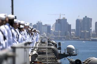 Sailors man the rails aboard the aircraft carrier USS Theodore Roosevelt.