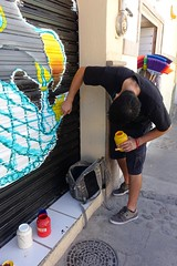 Painting a metal shutter (posterboy2007) Tags: ajijic mexico shutter metal art shop painting