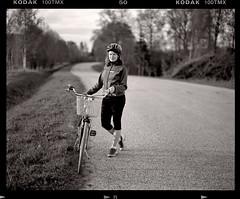 Cycling Days (tsiklonaut) Tags: pentax 6x7 67 film analog analogue analogica analoog 120 medium format kodak tmax 100 bw estonia eesti cycling bicycle woman helmet bokeh dof road riding drum scan drumscan scanner pmt photomultipliertube jalgratas jalgrattur