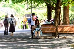 Tree Shade (Ueno Zoo, Tokyo) : 木陰(上野動物園) (Dakiny) Tags: 2018 summer july japan tokyo taito ueno outdoor nature park uenopark city street people woman girl tree bench bokeh nikon d750 sigma apo 70200mm f28 ex hsm apo70200mmf28dexhsm sigmaapo70200mmf28dexhsm nikonclubit