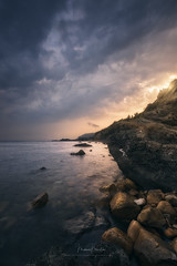 Sunset over the sea (Manuel.Martin_72) Tags: italy elba lightdrama coast rocks sand stones reflections sea water waterreflections clouds cloudy glow sun sunset evening wbpa i