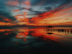 painted skies (eva michie) Tags: sunset ocean cool blue orange red yellow sun beach landscape landscapes interesting photography beautiful reflection water skies clouds awesome canon camera digital iphone challengegamewinner amazing sky nationalgeographic national geographic beaches oceans waters seas outerbanks outer banks