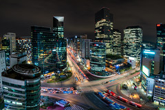 Night scene of light trails traffic speeds through an intersection in Gangnam center business district of Seoul at Seoul city, South Korea. (MongkolChuewong) Tags: aerial aerialview architecture asia asian background blur building business cars center city cityscape civil concept congestion district downtown fast gangnam growth hectic high hurried intersection korea korean light megacity modern motion night office pace palace panorama road scene seoul skyline south speed street time traffic transportation travel urban vehicles view