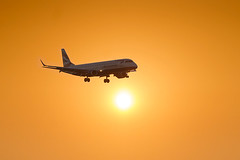 Sunset Arrival (adrians_art) Tags: londoncityairport docklands airplanes jets flight flying travel isleofdogs city london uk england silhouettes shadows landing runway aircraft sunset evening sky clouds orange gold yellow red blackandwhite