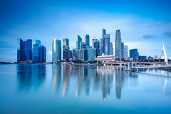 Singapore city skyline at the Marina bay during sunrise (Patrick Foto ;)) Tags: architecture asia asian bay blue buildings business city cityscape dawn day district downtown dusk evening famous financial harbor landmark landscape location marina metropolis modern morning museum night panorama panoramic place reflection scene scenery scenic science sea singapore sky skyline skyscraper skyscrapers southeast sunlight sunrise sunset twilight urban view warm water sg