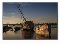Pin Mill (mobile103) Tags: bluesky decay sunk shorelines boats sunset wood shipwrecks tide water longexposue
