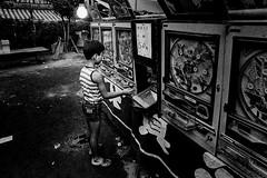 temple festival 684 (soyokazeojisan) Tags: japan osaka bw night light city blackandwhite 縁日 children analog olympus m1 om1 21mm neopansss fujifilm film memories 昭和 1970s 1975
