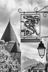 Logo and castel (SLpixeLS) Tags: switzerland bulle logo monochrome blackandwhite sky cloud sign emblem castel