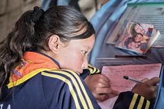 Schoolgirl in a class of Laya - Gasa District - Snowman Trek - Bhutan (PascalBo) Tags: nikon d500 asie asia southasia asiedusud drukyul drukgyalkhap bhutan bhoutan འབྲུག་ཡུལ། འབྲུག་རྒྱལ་ཁབ་ snowman trek trekking hike hiking lunana gasa himalaya himalayas jigmedorjinationalpark laya layap people kid child enfant girl fille school pascalboegli indoor indoors indigenous