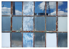 window with the blues (mcfcrandall) Tags: window glass blue sky reflections clouds frame metal panes rectanglesgeometry shapes