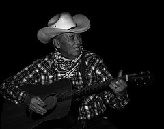 024693763555-102-Singing Cowboy-3-Black and White (Jim There's things half in shadow and in light) Tags: yellow people cowboy countrymusic guitar musicalinstrument musician redrockcanyon nevada america desert