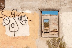 Glyph (garshna) Tags: glyph graffiti windows door abandoned ruins weathered sky adobe