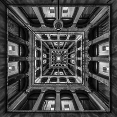 Venetian Illusion (Blende1.8) Tags: venice venedig photoshop composing illusion square lichthof patio inneryard old historic architecture architektur building innenhof windows fenster quadrat mono monochrome monochrom schwarzweiss black white bw sw italy italien venezia italia carstenheyer symmetry