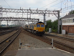 66744 Passing stockport with its train from hope street to peak forest. (rharwood75) Tags: gbrf train locomotive station platform signal box gantry class66 stone shed crossrail