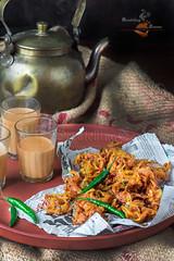 Pyazi, Onion Pakora (Rimli D) Tags: foodstyling foodblog foodphotography foodblogger foodpicture foodporn food fastfood streetfood comfortfood fried kolkatafood marathifood bengalifood bangladeshifood stilllife staples indianfood rusticfood moodyshot monsoon maharashtrianfood kandabhaji onionpakora fritters snack desikhana nikon iamnikon nikkor
