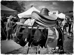 Hats in Black and White (PEN-F_Fan) Tags: mzuiko17mmf18 m43 mft microfourthirds mirrorless olympuspenf primelens raw photoborder photoedge photoframe hatrack hat people market outdoor sky clouds blanco texas unitedstates blackandwhite monochrome filmlook preset postprocessing skylum luminar2018 tonalityck