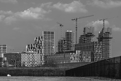 Upper Riverside - 20.4.18 (Ryan Trower Photography) Tags: skyscrapers london nikon d5300 architecture construction black white building structure skyscraper lines sky monochrome geometric city urban street tower facade concrete glass towers photography architect architects residential commercial sigma samyang som skidmore owings merrill greenwich peninsula road people nikond5300 greenwichpeninsula upperriverside skidmoreowingsandmerrill londonarchitecture londonconstruction