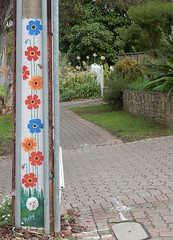 Stobie with Flowers (mikecogh) Tags: stobiepole telegraphpole flowers decorated pavers footpath pavement poppy publicart glenalta