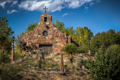 Stone Church near Espanola, NM (donnieking1811) Tags: newmexico espanola church cross stone bell exterior outdoors trees sky clouds blue hdr canon 60d lightroom photomatixpro