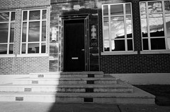 golden hour in the big city (fallsroad) Tags: tulsaoklahoma city urban eastvillage blackandwhite bw monochrome architecture building door stairs