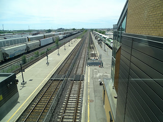 Oshawa Photo: Looking West From VIA Walkway At CN Mainline, GO Transit Oshawa Station With Westbound Train About To Depart And CN Oshawa Yard
