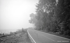 Looking Back (mswan777) Tags: ansel white black monochrome 1020mm sigma d5100 nikon weather mist fog forext tree stone scenic nature outdoor bicycle bike road shore water michigan island mackinac