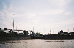 Coming past the Entrance Lock (knautia) Tags: entrancelock floatingharbour cumberlandbasin riveravon bristolferry bristol england uk july 2018 film ishootfilm olympus xa2 olympusxa2 kodak kodacolor 200iso nxa2roll36 river avon ferry bridge