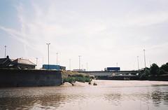 Plimsoll Bridge and the silted up lock, from the ferry (knautia) Tags: cumberlandbasin riveravon bristolferry bristol england uk july 2018 film ishootfilm olympus xa2 olympusxa2 kodak kodacolor 200iso nxa2roll36 river avon ferry bridge plimsollbridge