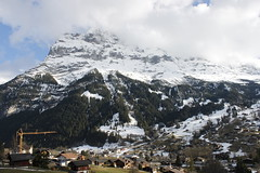 First glimpse of the Eiger (Magryciak) Tags: switzerland 2018 travel trip mountain mountains holiday vacation roadtrip snow hill outdoors village cloud eiger grinderwald canon eos landscape