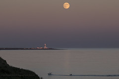 Tubing under the Strawberry Moon (Spookwoman) Tags: hooklighthouse wexford dunmoreeast waterford ireland strawberry moon fullmoon full landscape landmark tubing water sports seascape