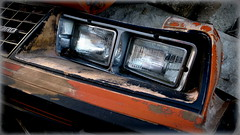 lights.... out (milomingo) Tags: metal glass headlight car automobile machine closeup photoborder abandoned orange blue decay metallic inorganic outdoor moribund stateofdecline grain texture geometry dichotomy