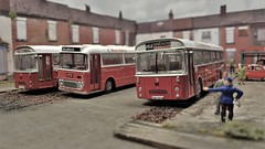 Temporary Coach Park. (ManOfYorkshire) Tags: corgi ooc efe bus buses coaches coach spare land demolition houses parked temporary overflow park parking oogauge 176 scale diecast diorama yorkshiretraction west riding dualpurpose national nationalbuscompany poppyred nbc localcoach livery bradford doncaster model
