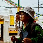 Woman and young man walking around Boudhanath Stupa in Kathmandu, Nepal thumbnail