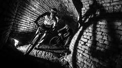 Driving through catacombs. (Originalni Digitalni) Tags: canon canoneos60d festung giant originalnidigitalni sb sbbl slavonskibrod art fotografija mtb photo photography umjetnost utrka blackandwhite monochrome bicycles mountainbike race tomislavlačić tvrđava