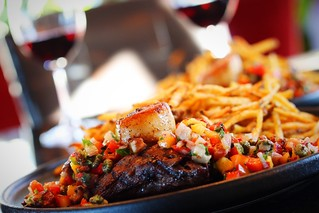 Beef steak with seared scallop, homemade fries and virgin sauce.