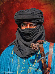 The Eyes Have It (Dick Shaffer) Tags: portrait venice italy carnevale arab costume eyes blue red sword stare