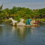 Lake with animal sculpture fountains in the evening light in Muang Boran (Ancient Siam) in Samut Phrakan province, near Bangkok, Thailand thumbnail
