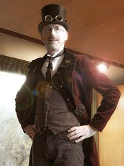 Mr Steampunk - Neave R Willoughby (Steve Taylor (Photography)) Tags: neaverwilloughby steampunk costume goggles waistcoat fobwatch tie glasses stage tophat fashion portrait light lamp brown man newzealand nz southisland canterbury christchurch lensflare antique digitalart
