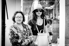 Shopping (Cycling Road Hog 2018) Tags: blackwhite candid canoneos750d citylife colour efs55250mmf456isstm edinburgh fashion hat lipstick monochrome people places royalmile scotland shades street streetphotography streetportrait style urban