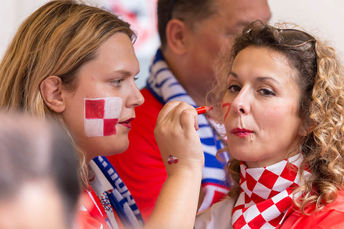 Croatian female soccer fans painting their faces