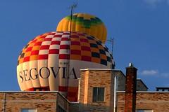 Invasión globular (alfonsocarlospalencia) Tags: globos segovia fiesta invasión sorpresa amanecer colorido veraño amarillo ventanas cuadrados despertar luz antenas choque