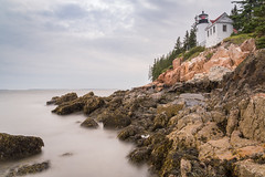 Bass Harbor Head Lighthouse revisited (Brinkervelt.) Tags: bassheadlighthouse maine mtdesertisland shutter exposure waves movement moody overcast clouds cloudy beautiful lighthouse rocks rocky light shore sea ocean trees shoreline coastal seascape outside outdoors