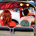 Woman with red hair riding in a tuktuk in Bangkok's Chinatown