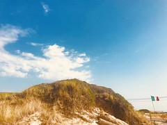 Italy (marcus.greco) Tags: cliff landscape nature sky italy green beach flag sea
