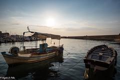Sunset...... (Lupogrande25) Tags: sunset boats sea harbour sun light clouds sky chania crete greece tramonto grecia ngc