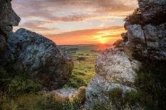 Last Glimpse (garethleethomas) Tags: rocks sunset sun countryside wales outside grass nature sky clouds landscape rock