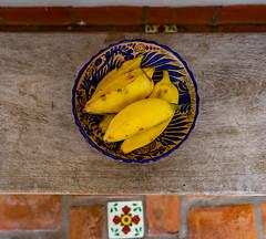 Platanos (jbird4s) Tags: platanos food bananas patio mexico yellow pottery blue bowl tile bench talavera