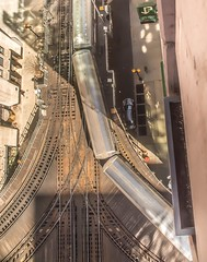 Above the El . . . (Dr. Farnsworth) Tags: el elevatedrailroad trains tracks cars above buildings street life chicago il illinois spring april2018 ngc nationalgeographic discoveryaward