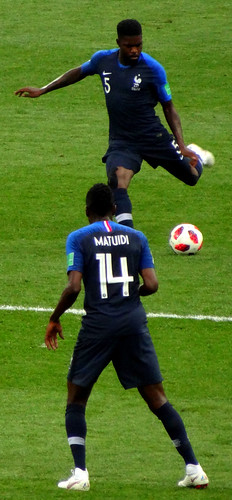 Samuel Umtiti of France clears the ball as Blaise Matuidi watches at the 2018 World Cup Final in Moscow