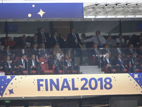 Didier Drogba checks his phone as he waits for the 2018 World Cup Final to begin